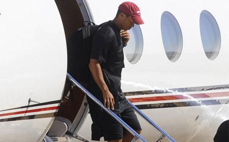 Tiger Woods exits his jet.