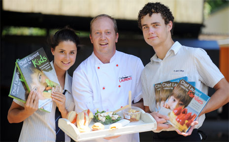 St Johns tuckshop chef Laurent Vancam (centre) launches his new cookbooks with students Renae Redgen and Jack Hurley.