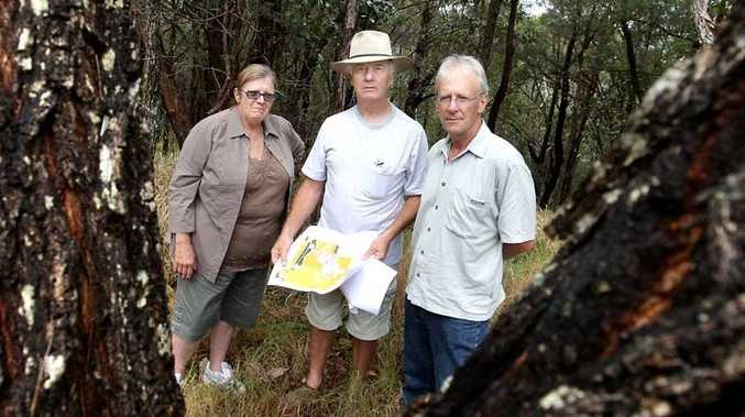 Tweed Shire councillor Dot Holdom (left) talks with Koala Beach residents' spokesman Alan Johnston (centre) and Cr Barry Longland about plans for a mobile phone tower in their neighbourhood.