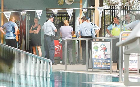 Police make enquiries at the Goodna Aquatic Centre after a young girl was found unconscious in the pool.