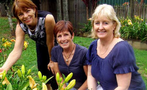 LYN Sullivan, vice-president of the Mt Warning AM Rotary Club, treasurer Vicki Rayner and president Cathy Akehurst all agree these daylilies will put on a wonderful show.