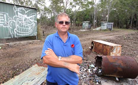 BEAUTY TRASHED: Roy Lucas is concerned that illegal dumping and vandalism such as in this photo has ruined a swimming hole in Nankin.