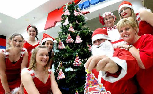 Kmart crew members celebrate the launch of their annual Wishing Tree appeal.