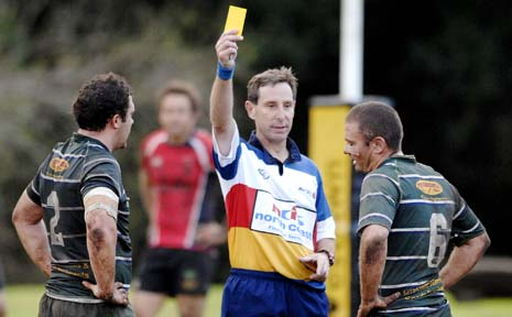 Graham Cook dishes out a yellow card in a FNC first-grade game. Cook will referee in the Dubai Rugby Sevens next month.