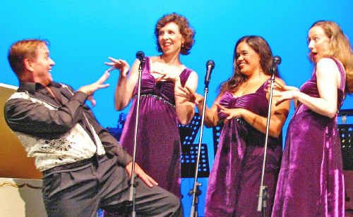 Peter Allen (Paul Farrell) gets in the groove with his backing trio (Anne Staunton, Liz Dargin and Meredith Betts) in The Boy from Oz.