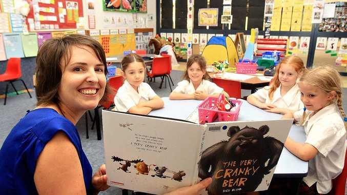 Kindergarten teacher Erin Brown with her students, Jessica Courtney, Tori Jones, Eliza Lovett and Charlotte Sterne.