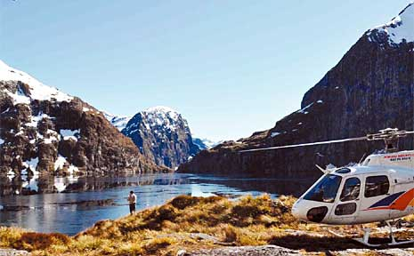 One of the best ways to see New Zealand is a helicopter ride over Milford Sound, which lands on a glacier and offers a stroll on ice.
