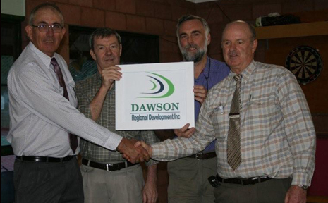 FACE LIFT:Robert Hutchinson, Doug Adam, Don Morris, and Banana  Mayor John Hooper unveil the new name and logo of Dawson Region Development.