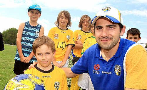 Soccer fanatic Zane Stewart is pictured with his mates and Gold Coast United midfielder Steve Pantelidis at Zane's his ninth birthday party.