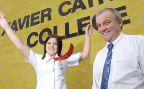 HEADING OUT: Xavier Catholic College student Courtney Wells jumps for joy in the presence of principal Eric Littler after completing her final HSC exam yesterday.