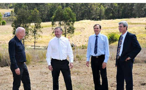 Abbi Group construction company bosses Peter Webb, left, and Peter Fitzgerald, right, on site with the federal government's Anthony Albanese, second left, and Dennis Tennant of Main Roads.