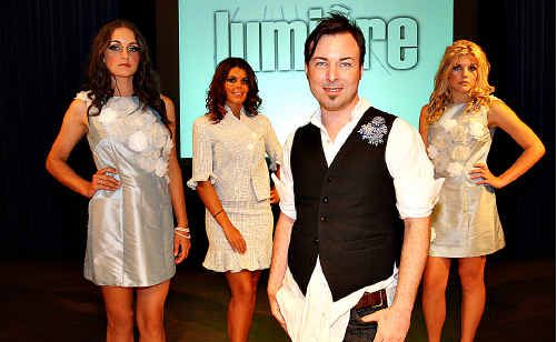 Project Runway runner-up Leigh Buchanan with models Leah Freney, Anna Bergstrom and Katija Burcul modelling student Amy Minns' designs.