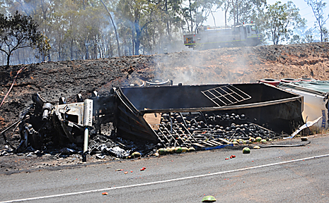 A semi-trailer rolled and burst into flames after an accident at the Isis River Bridge on the Bruce Highway. The driver escaped unharmed.