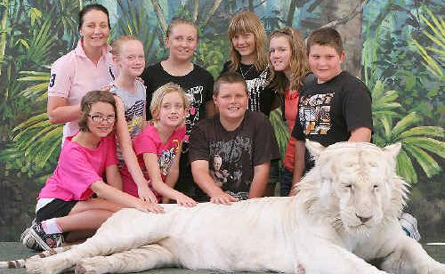Montana Gordon, Rachel Terry, Maddison Hack (front) Jessica Edwards, Paige Lawton, Rhianna Nurse, Haidee Arnold, Abbey Madders and Maximus Smith (back) get some hands-on learning with Mohan on Tiger Island.