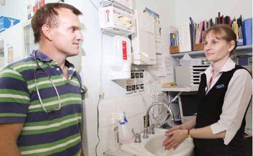 Dr Mark Brown and Melissa Hulme at Northside Plaza Medical Centre demonstrate good hygiene.