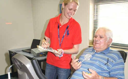 Exercise physiologist Julie Barnes records the progress of Alan Green during the new pulmonary rehabilitation program at Community Health in Rockhampton.