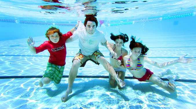 Friends Ashley Roberts, Matthew Roberts, Billie-Jo MacKenzie and Georgina Tully escape the heat at the South Rockhampton swimming pool.