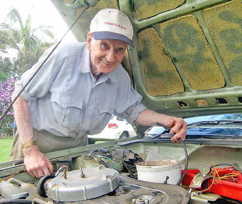 Bill with the hydrogen cell he has installed on his Subaru station wagon.