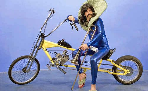 Tino La Bamba is an explorer. With his latex suit, golden trumpet and mean wheels, he's biking from Sydney to Lismore. Why? Dunno.