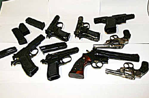These eight handguns were seized from two properties near Warwick during organised crime raids.