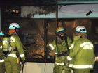 BAKERY BLAZE: Biloela firefighters prepare to clean up after extinguishing the blaze that destroyed Biloela's Simmon's Bakery last Friday night.