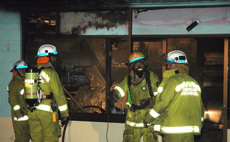 BAKERY BLAZE: Biloela firefighters prepare to clean up after extinguishing the blaze that destroyed Biloela's Simmon's Bakery last Friday night.