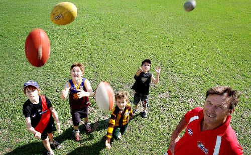 Dominic Trevaskis puts juniors through some AFL drills in the lead-up to next season: Charlie Trevaskis, 8, (Lions jersey), Jack Lee-Johnson, 8, (Hawthorn jersey), Lochlan Sheldon, 10, (Bombers jersey) and Mayto Gray-Morrison, 6.