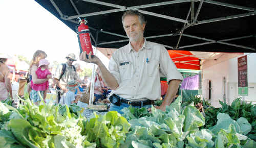 Kenrick Riley, at his lettuce stall yesterday. Mr Riley thinks new state laws that will require him to have a fire extinguisher and blanket at his stall are ridiculous.