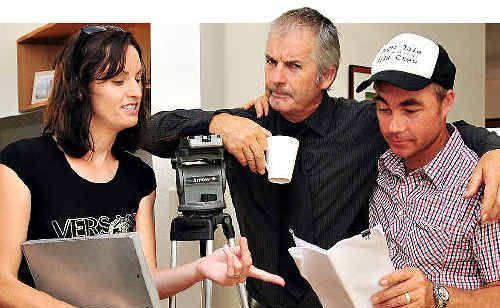 NO LAUGHING MATTER: John Jarratt, middle, who toiled for months to perfect his Wolf Creek character's sinister cackle, Cyber Sin producer Evette Henderson and director Matt Inglis take a break in shooting at Marcus Beach.