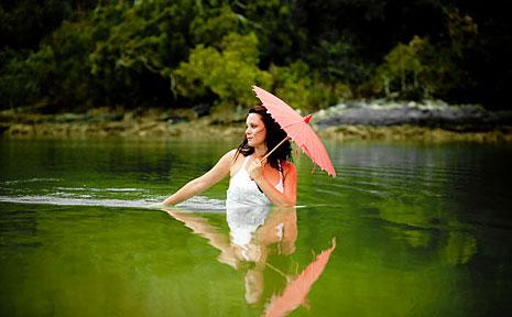 Kylie Keioskie (nee Sagar) drowns her gown at a creek in Coffs Harbour.