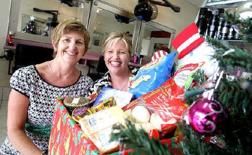 Strands Hairdressing owners Jeni Harvey and Bronwyn Galante have adopted two families this Christmas.