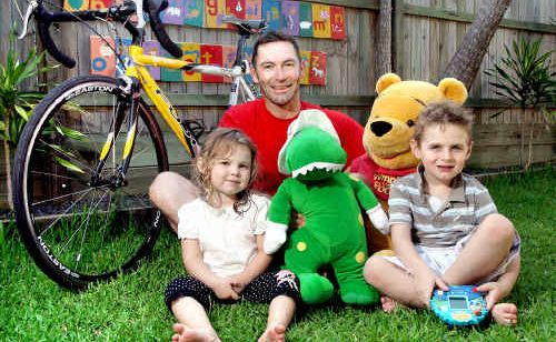 Mat Britton – with his two children, Lily, 3, and Alec, 5 – will ride in a Springfield charity toy bike ride as well as a fundraiser from Sydney to the Gold Coast.