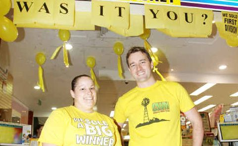 Country Wide News general manager Dale Barnes and Tina Barton, who sold the winning lotto ticket, celebrate the massive win for a Rockhampton man.