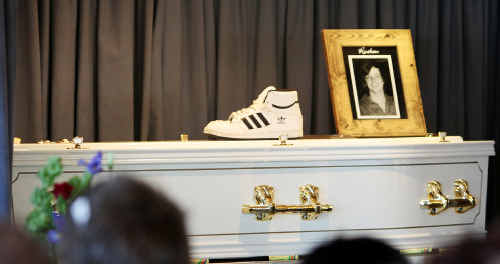 Rueben Barnes' coffin is marked with a pair of his skate shoes at his funeral service in Rockhampton.
