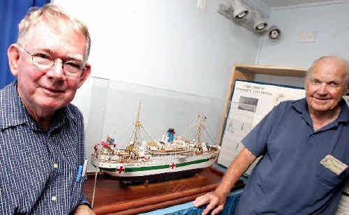 Historians at the Tweed River Regional Museum Robert Guthrie and Robert Ford examine a model of the World War II hospital ship, the Centaur.