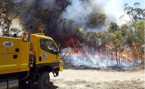 Firefighters are testing air after a blaze burned 150 hectares near Koppers Wood Products on Monday.