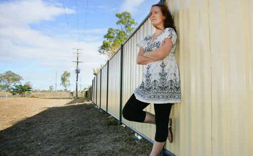Gracemere resident Carly Hill was not impressed when vandals kicked down her back fence.