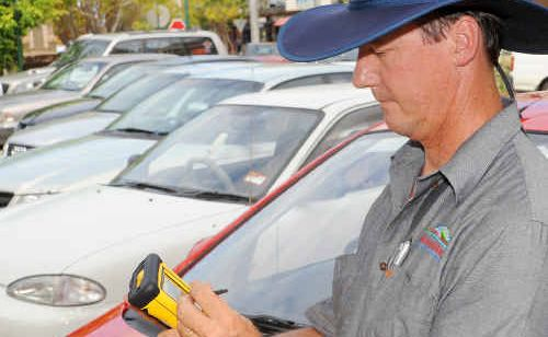 Bundaberg Regional Council regulated parking officer David Bagley issues tickets in the CBD.