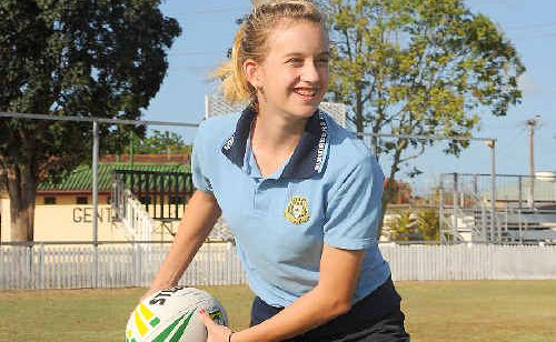 Adelaide Baumann wants to play women's rugby league and attends a training session at Salter oval held by Australian Rugby League development officer Matt Palin.