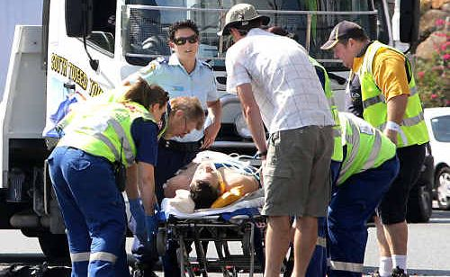 A motorcyclist whose bike collided with a semi-trailer on Sexton Hill on Friday is in a Brisbane hospital.