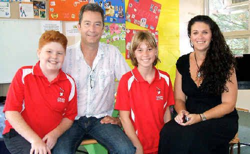 Reverend Brian Bruce and Niomi Harry from the Church of Christ in Tweed Heads with Terranora Public School students Oscar Harrison, 12, and Brooke Quarmby, 12.
