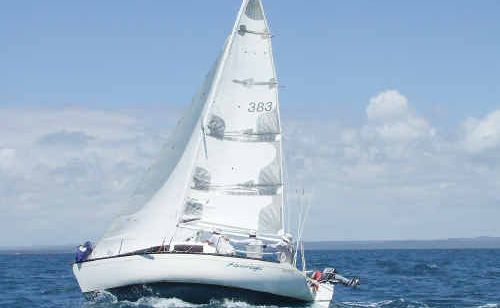 Aquamagic, sailed by David Lewis, competes in race three of the Hervey Bay Boat Club Yacht Squadron's summer series.