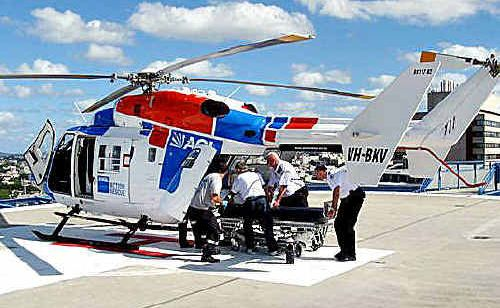 The injured man is placed in the AGL Rescue Helicopter to be taken to Royal Brisbane Hospital.