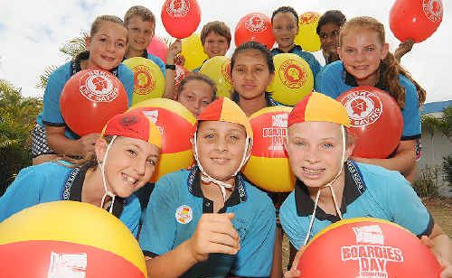 Avoca State School students Tayla Whalley, Liam Laine, Hannah Sewell (front) Maddie Appleton and Gaby Snow (middle) Kendal Praed, Matthew Crane, Mitchell Kiss, Darcy Milligan, Adra Aditya and Teah Seaward (back) take part in Boardies Day and help raise funds for Surf Life Saving.