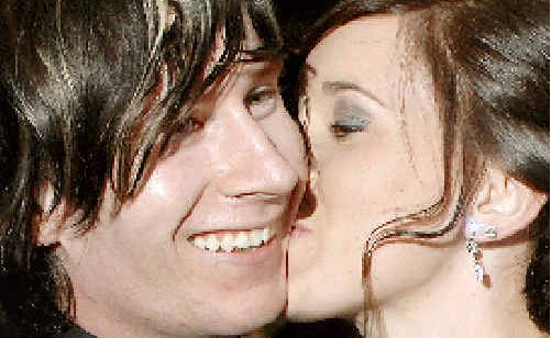 Nikki Scofield plants a kiss on the cheek of her boyfriend Nick Daley after accepting his wedding proposal outside the Lismore Workers Club on the evening of Nikki's school formal.