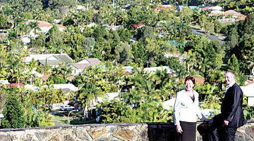 Councillor Debbie Blumel and Justin Holbrook overlook Coast roofs.