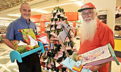 Kmart store manager Matthew Dodd and Keith Lanham admire the bountiful tree.