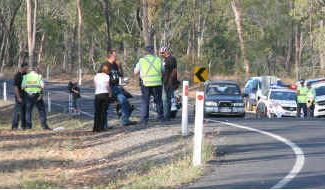 Police interview the friends of a motorcyclist who sustained fatal injuries when his Harley Davidson failed to negotiate a bend on the Childers-Biggenden Road and struck a tree.
