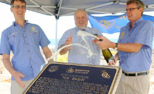 Bargara Rotary Club president Ross Fisher, Cr Tony Ricciardi and Rotary Club secretary Rod Medew celebrate Q150 with the unveiling of one of nine coastal plaques.