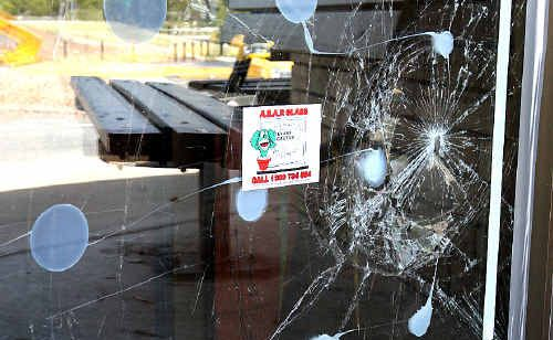 ONE of the smashed windows.